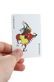 Playing card Joker in your hand Stock Images