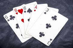 Five playing card`s stud hand three of a kind six and ace a three fun stock photography