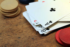 Playing card and poker chips Royalty Free Stock Photo