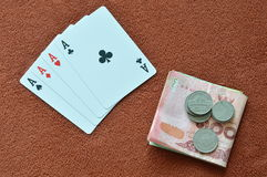 Playing card showdown ace and money on table Royalty Free Stock Photography