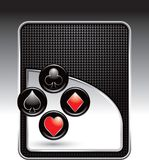 Playing card suits on black checkered backdrop Stock Images