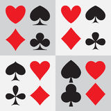 Playing card suits: four different types of design Stock Images