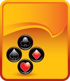 Playing card suits on orange rip curl banner Stock Photography