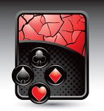 Playing card suits on red cracked backdrop Royalty Free Stock Images