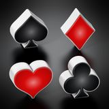 Playing card suits symbols standing on black background. 3D illustration.  Stock Photo