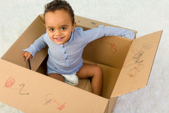 Playing in a cardboard box Royalty Free Stock Photo