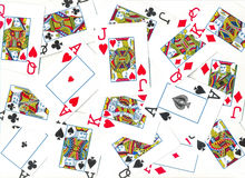 Playing cards. Of different colors on the table isolated on white background Royalty Free Stock Images
