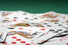 Playing cards. Piled on green Royalty Free Stock Photo