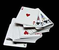 Playing cards. Displays various playing cards on a black background Stock Images