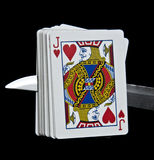 Playing cards. Displays a deck of cards pierced by a knife Royalty Free Stock Images