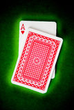 Playing cards. On green cloth royalty free stock photo