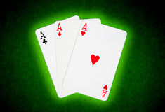Playing cards. On green cloth Stock Photos