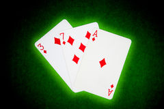 Playing cards. On green cloth Royalty Free Stock Photos