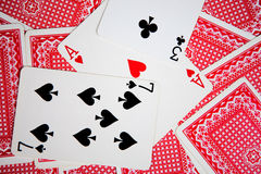 Playing cards. On green cloth royalty free stock photography