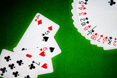 Playing cards. On green cloth Royalty Free Stock Images