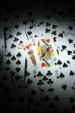 Playing Cards. King and Queen of hearts open among a bunch of playing cards Stock Image