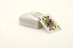 Playing cards. Queen of hearts coming out from a pack of playing cards Stock Photos