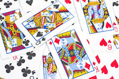 Playing Cards. Organised randomly for use as a background or games related concept Stock Photos