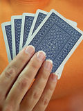 Playing cards. Woman's hand holding cards royalty free stock images