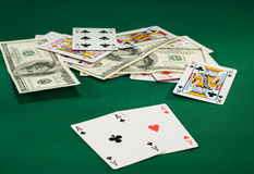 Playing cards. And money on the green cloth royalty free stock image