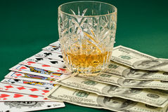 Playing cards. And money on the green cloth stock photography