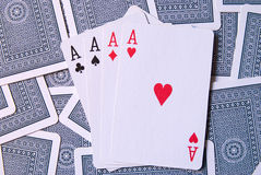 Playing Cards with 4 aces. Playing Cards lying uppside down Royalty Free Stock Photos