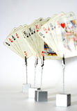Playing cards. Details of playing cards arranged in four-of-a-kind.  Aces, Kings, Queens Stock Photography