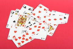 Playing cards. Printed on red background Stock Images
