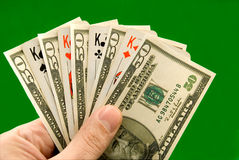 Playing cards. And fifty - dollar denominations on a green background Stock Photo