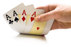 Playing cards. A man's hand holding new playing cards royalty free stock images