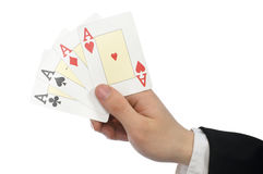 Playing cards. A man's hand holding new playing cards stock photography