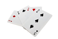 Playing cards. Four playing cards isolated over white Stock Images