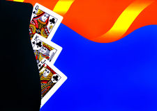 Playing Cards. Arranged on colorful graphic background Royalty Free Stock Photo