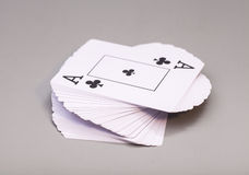 Playing cards with ace of clubs. Isolated on gray background Stock Photography