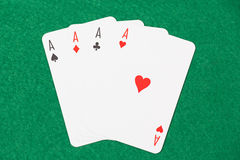 Playing cards - aces on green table Stock Photo