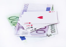 Playing cards aces over money Royalty Free Stock Photo