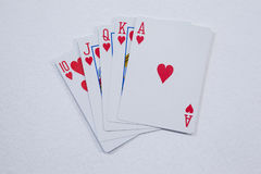 Playing cards arranged on white background. Close-up of playing cards arranged on white background Royalty Free Stock Images