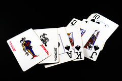 Playing cards. Cards on a black background Royalty Free Stock Image