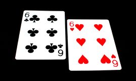 Playing cards on black background - game tool royalty free stock images