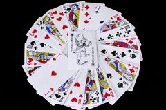 Playing cards on black background. stock image