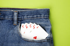Playing cards in blue jeans pocket Stock Images