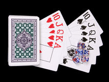 Playing cards and bones. Playing cards and playing bones on a black background Royalty Free Stock Image
