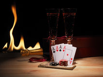 Playing cards and a bottle of champagne in box Stock Photos