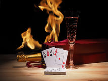 Playing cards and a bottle of champagne in box Stock Image