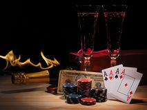 Playing cards and a bottle of champagne in box Royalty Free Stock Photography