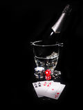 Playing cards and a bottle of champagne in bucket Royalty Free Stock Images