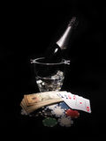 Playing cards and a bottle of champagne in bucket Royalty Free Stock Photo