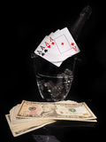 Playing cards and a bottle of champagne in bucket Stock Photography