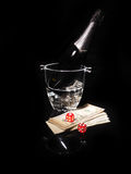 Playing cards and a bottle of champagne in bucket Royalty Free Stock Photography