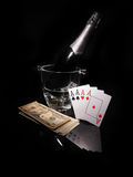Playing cards and a bottle of champagne in bucket Stock Photos